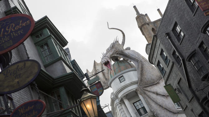 "This June 2014 photo released by Universal Orlando Resort shows ""The Wizarding World of Harry Potter – Diagon Alley,"" from the Harry Potter-themed area of Universal Orlando Resort in Orlando, Fla. The attraction, featuring shops, dining experiences and the next generation thrill ride, will officially open on July 8. (AP Photo/Universal Orlando Resort, Sheri Lowen)"