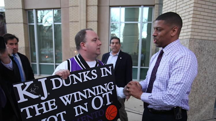 Sacramento Mayor Kevin Johnson, right, thanks Sacramento Kings fan Shawn Jonas for his support  prior to the Sacramento City Council meeting, where a vote will be taken on a new sports arena proposal, in Sacramento, Calif. Tuesday, March 6, 2012.  A year after almost being wiped off the NBA basketball map, Sacramento can secure its place in the league when the City Council votes on a plan to help finance a $391-million arena. Approval would keep the Kings where they are for at least another 30 years. (AP Photo/Rich Pedroncelli)