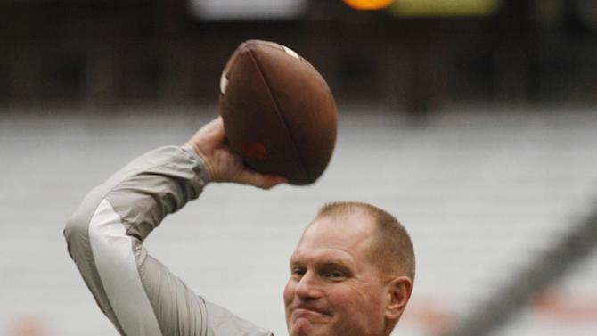 Syracuse's head coach Scott Shafer tosses a football before an NCAA college football game against Maryland at the Carrier Dome in Syracuse, N.Y., Saturday, Sept. 20, 2014