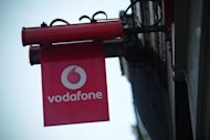 Mobile phone giant Vodafone on Tuesday revealed it had slumped into a net loss of £1.977 billion during its first half on massive writedowns linked to indebted eurozone countries Spain and Italy