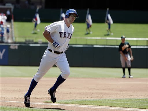 Rangers top A's 3-1 in Wolf's 1st big league start