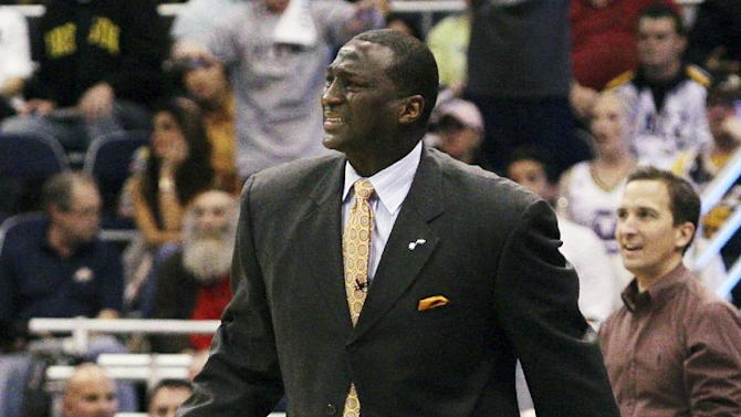 Utah Jazz head coach Tyrone Corbin reacts to a foul called on his team during the first half of Game 3 against the San Antonio Spurs in their first-round NBA basketball playoff series, Saturday, May 5, 2012, in Salt Lake City. (AP Photo/Colin E Braley)