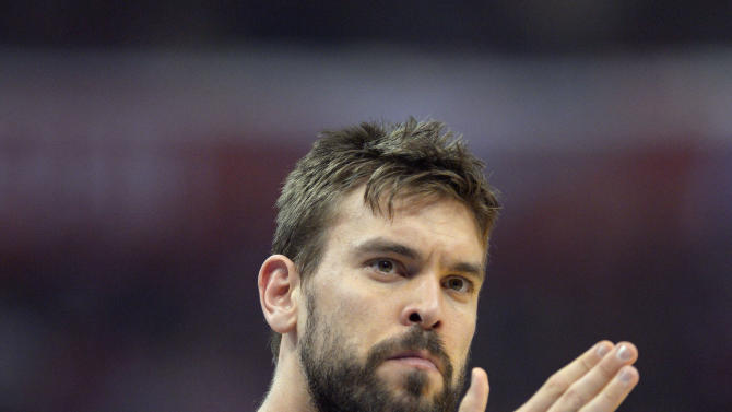 FILE - In this April 22, 2013, file photo, Memphis Grizzlies center Marc Gasol, of Spain, applauds during the first half of Game 2 of a first-round NBA basketball playoff series against the Los Angeles Clippers in Los Angeles. Gasol was selected as the NBA's defensive player of the year, the league announced Wednesday, April 24, 2013. (AP Photo/Mark J. Terrill, File)