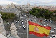 <p>The Spanish flag flys at the Plaza de Cibeles in the Spanish capital Madrid, on April 25. An exceptional police presence was in place in Barcelona ahead of next week's key European Central Bank meeting, with authorities fearing violence in Spain's climate of social unrest.</p>