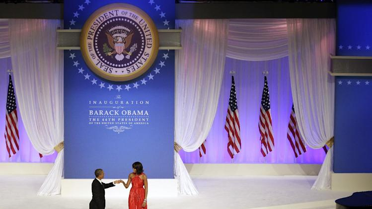 President Barack Obama greets first lady Michelle Obama as she arrives on stage during the Commander-In-Chief inaugural ball at the Washington Convention Center during the 57th Presidential Inauguration Monday, Jan. 21, 2013, in Washington.  (AP Photo/ Evan Vucci)