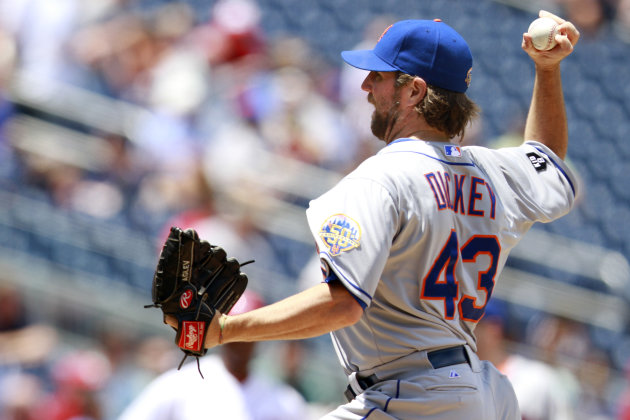New York Mets starter R.A. Dickey pitches against the Washington Nationals during the second inning of a baseball game at Nationals Park in Washington, on Thursday, June 7, 2012. (AP Photo/Jacquelyn Martin)