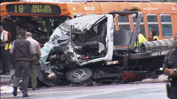 Tow truck driver in bus crash didn't have valid driver's license