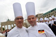 French chef Bernard Vaussion (L) and Germany's Ulrich Kerz pose in front of the Brandenburg gate. World leaders' personal chefs, a group known as one the globe's most exclusive culinary clubs, gathered in Berlin Thursday to swap tips on how to keep their powerful bosses healthy and happy