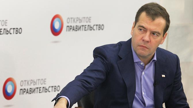Russian Prime Minister Dmitry Medvedev speaks at a meeting with experts at the Higher School of Economics in Moscow on Wednesday, July 25, 2012. (AP Photo/RIA Novosti, Yekaterina Shtukina, Government Press service)