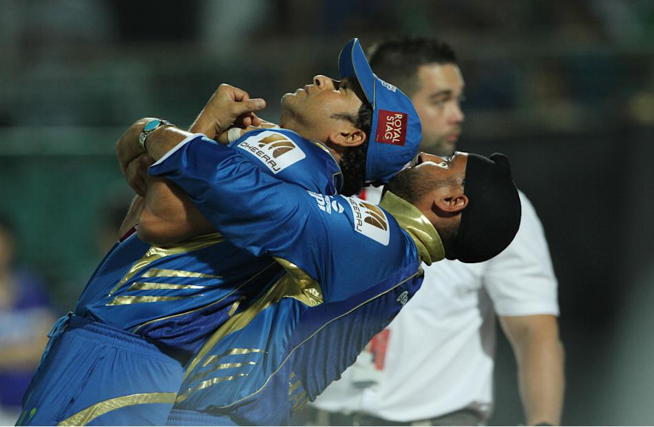 Mumbai Indian player Sachin Tendulkar and Mumbai Indian player Harbhajan Singh warm up during match 23 of the Pepsi Indian Premier League ( IPL) 2013  between The Rajasthan Royals and the Mumbai India