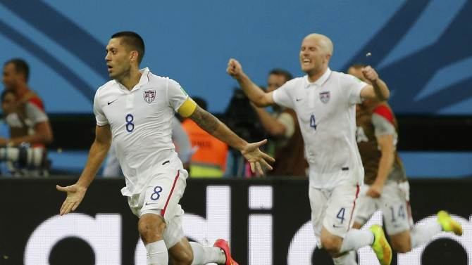 Dempsey of the U.S. celebrates with his teammate Bradley after scoring a goal against Portugal during their 2014 World Cup Group G soccer match at the Amazonia arena in Manaus