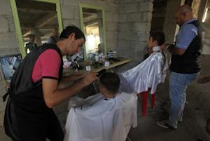 Iraqi Christians get a free haircut from barbers inside …