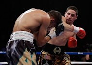 Danny Garcia (right) throws a punch at Amir Khan Garcia during their title fight at Mandalay Bay Events Center on July 14 in Las Vegas, Nevada. Khan should think about retirement following his defeat by Garcia, according to his world champion compatriot Carl Froch
