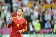 Spanish defender Sergio Ramos celebrates after scoring a penalty during the penalty shoot out at the Euro 2012 football championships semi-final match Portugal vs Spain at the Donbass Arena in Donetsk. Spain won 4-2