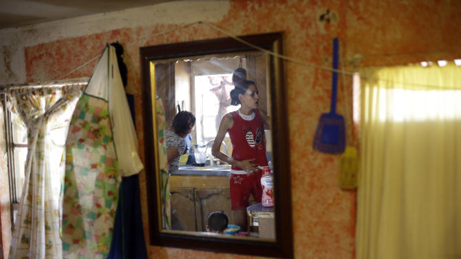 Illegal immigrants Sonia Limas, left, and her pregnant daughter, Gloriely Lopez, are reflected in a mirror at their home, Thursday, Sept. 6, 2012, in Alamo, Texas. When healthcare reform has been fully implemented, illegal immigrants will make up the nation's second-largest population of uninsured, or about 25 percent. The only larger group will be people who qualify for insurance but fail to enroll, according to a 2012 study by the Washington-based Urban Institute. (AP Photo/Eric Gay)