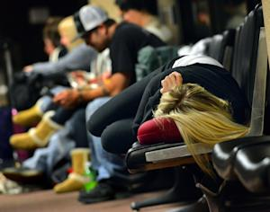 A woman waits for a flight at Phoenix Sky Harbor Airport …