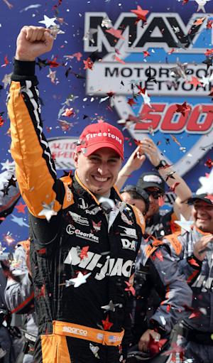 Graham Rahal celebrates after winning the IndyCar auto…