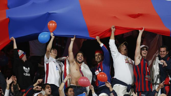 Fans of San Lorenzo cheer before the start of their semi-final soccer match against Auckland City in FIFA Club World Cup at Marrakech stadium