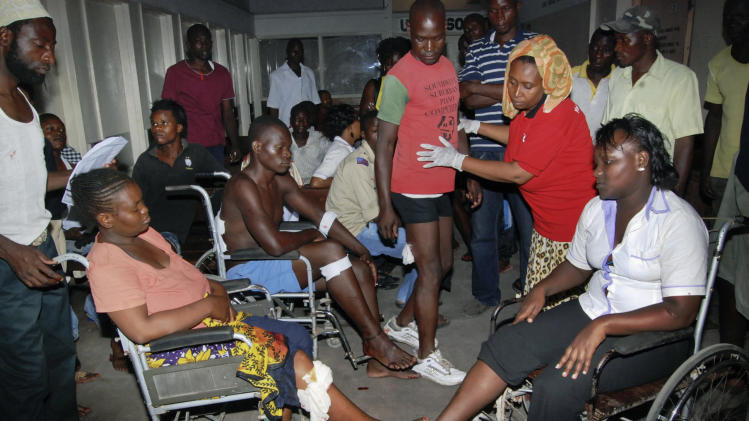 Some of those who sustained injuries from an explosion at a bar in the Mishomoroni district of Mombasa, which police at the scene said was a grenade attack, are treated at the Coast General Hospital in Mombasa, Kenya late Sunday, June 24, 2012. The explosion comes after the U.S. Embassy in Kenya on Friday warned of an imminent threat of a terrorist attack in Mombasa and said all U.S. government personnel had to leave the city. (AP Photo)