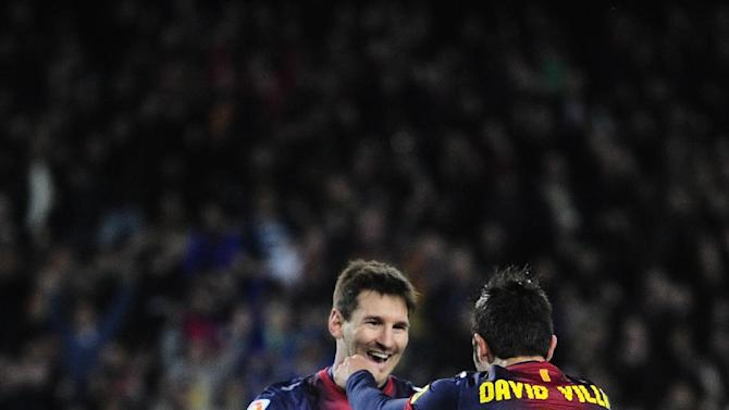 FC Barcelona's David Villa, right back, reacts after scoring with his teammate Lionel Messi, from Argentina, left, against Rayo Vallecano during a Spanish La Liga soccer match at the Camp Nou stadium in Barcelona, Spain, Sunday, March 17, 2013. (AP Photo/Manu Fernandez)