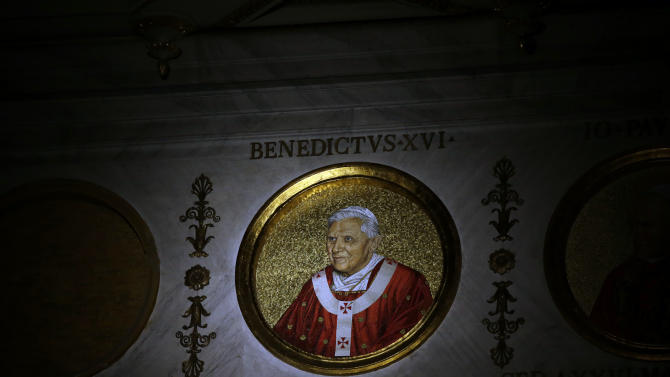 The icon of Pope Benedict XVI is lit inside the St. Paul outside the Walls Basilica in Rome, Monday, Feb. 11, 2013. Pope Benedict XVI said Monday he lacks the strength to fulfill his duties and on Feb. 28 will become the first pontiff in 600 years to resign. The announcement sets the stage for a conclave in March to elect a new leader for world's 1 billion Catholics. (AP Photo/Gregorio Borgia)