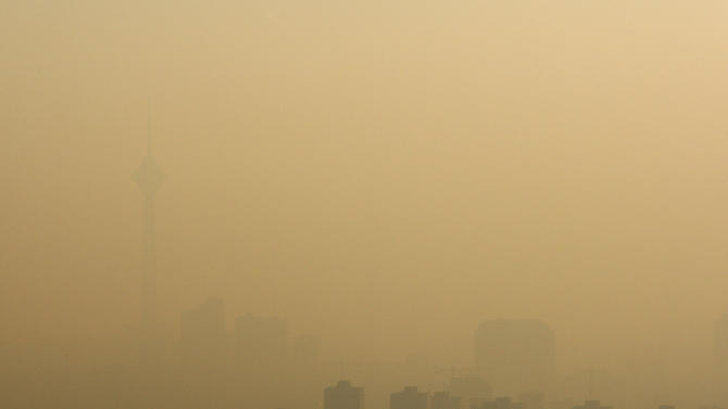 Milad telecommunications tower, left, and buildings are seen, shrouded in polluted air in Tehran, Iran, Wednesday, Dec. 1, 2010. Heavy air pollution has forced Iranian authorities to close government offices and declare a two-day public holiday in the capital, Tehran. (AP Photo/Vahid Salemi)