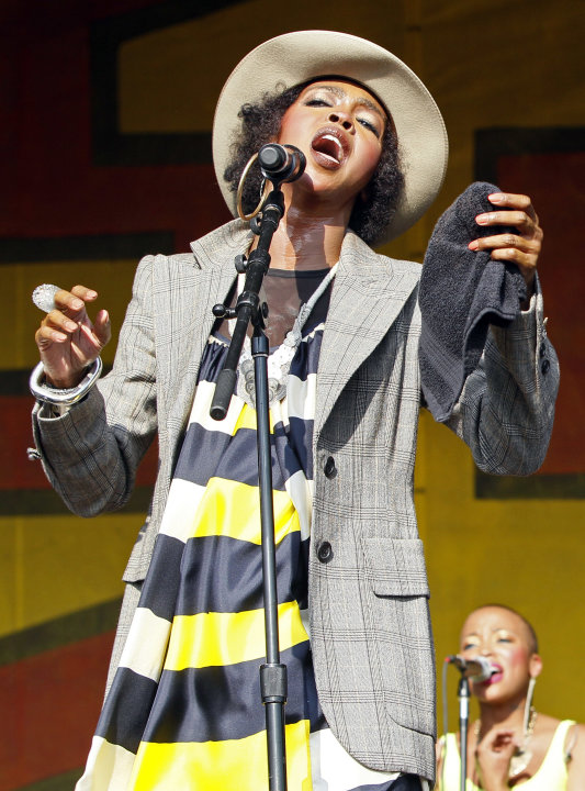 FILE - In this May 7, 2011 file photo, Lauryn Hill performs at the New Orleans Jazz and Heritage Festival in New Orleans.  Federal prosecutors have charged five-time Grammy winner Lauryn Hill with wil