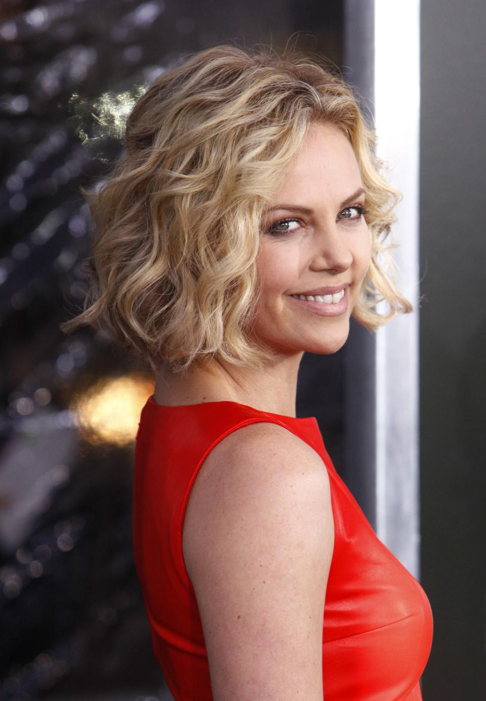 "Actress Charlize Theron attends the premiere of ""Young Adult"" at the Ziegfeld Theatre on Thursday, Dec. 8, 2011 in New York. (AP Photo/Peter Kramer)"