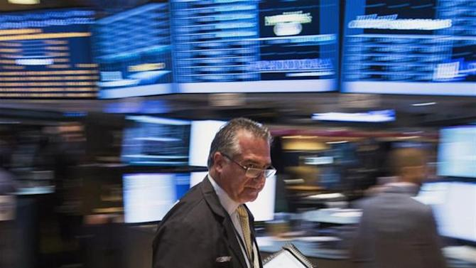 A trader works on the floor of the New York Stock Exchange shortly after the start of trading in New York, September 23, 2013. REUTERS/Lucas Jackson