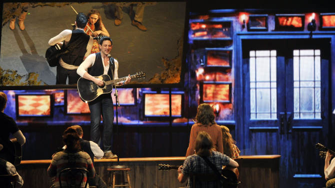 """Steve Kazee performs in a scene from """"Once"""" at the 66th Annual Tony Awards on Sunday June 10, 2012, in New York. (Photo by Charles Sykes /Invision/AP)"""
