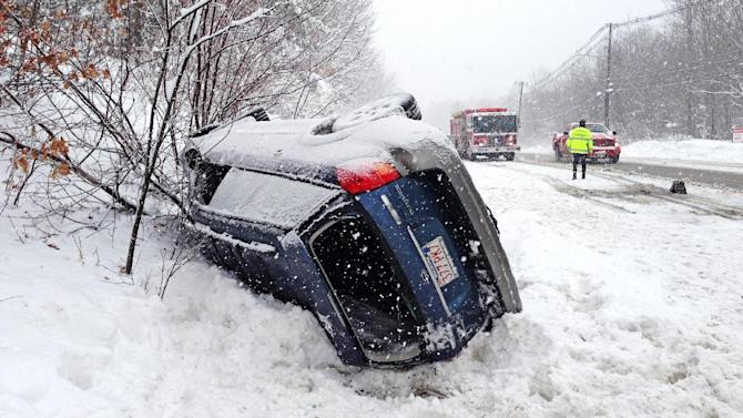 A Subaru Outback is rolled over on Rt 20 in Charlton, near the Sturbridge line, blocking part of the westbound lane Friday, March 8, 2013.  The National Weather Service reported that central Massachusetts, areas southwest of Boston and Middlesex County are getting the most snow from a slow-moving storm that hit Massachusetts harder than expected. (AP Photo/Worcester Telegram & Gazette, Dan Gould)