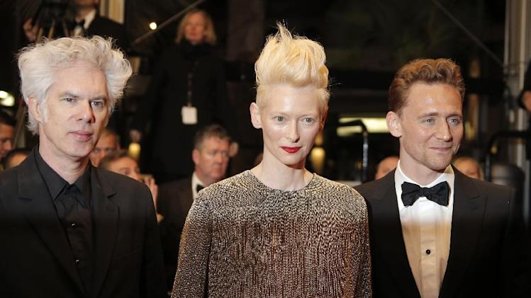 From left, director Jim Jarmusch, actors Tilda Swinton and Tom Hiddleston arrive for the screening of Only Lovers Left Alive at the 66th international film festival, in Cannes, southern France, Saturday, May 25, 2013. (AP Photo/Francois Mori)