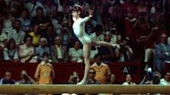Nadia Comaneci competes on the beam at the 1976 Olympics in Montreal
