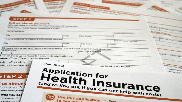 A draft copy of the 21-page of a Health and Human Services Department form proposed for use to apply for low-cost insurance from Medicaid or the Children's Health Insurance Program is photographed in Washington, Tuesday March 12, 2013. The government's application for health insurance, which uninsured people will use to get taxpayer subsidized coverage starting next year. Applying could get complicated, with multiple questions about income, household composition, employer coverage and even race and ethnicity. (AP Photo/J. David Ake)