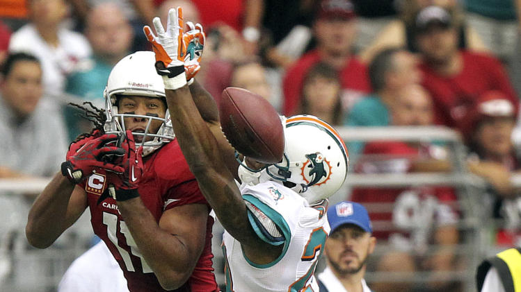 Miami Dolphins cornerback Sean Smith breaks up a pass intended for Arizona Cardinals wide receiver Larry Fitzgerald (11) during the first half of an NFL football game, Sunday, Sept. 30, 2012, in Glendale, Ariz. (AP Photo/Paul Connors)