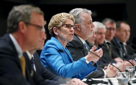Ontario's Premier Kathleen Wynne speaks during a news conference after the Quebec Summit On Climate Changes at the Hilton hotel in Quebec City