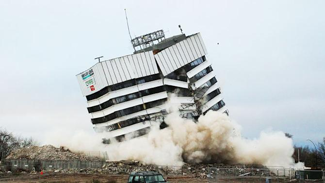A building is demolished by controlled explosions on August 5, 2012 in Christchurch, New Zealand. The 14-story Radio Network House building in Worcester St, is the first of its kind in the city to be blown up in a controlled demolition since authorities began the massive task of bringing down the hundreds of quake-damaged buildings. The building was badly damaged in the magnitude-6.3 February 22, 2011 earthquake. (Photo by Martin Hunter/Getty Images)