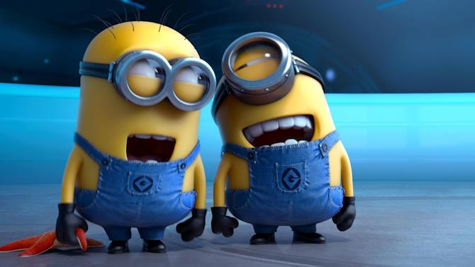 """FILE - This file photo provided by Universal Pictures shows the minion characters in the film """"Despicable Me 2."""" Domestic box office numbers so far on this long Fourth of July holiday weekend are suggesting the the animated minions of family favorite, with a price tag one third of what """"The Lone Ranger"""" cost to make, is outperforming the masked man by more than three to one. (AP Photo/Universal Pictures, File)"""