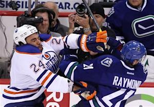 Canucks waste 3-0 lead, hold on to beat Oilers 5-3