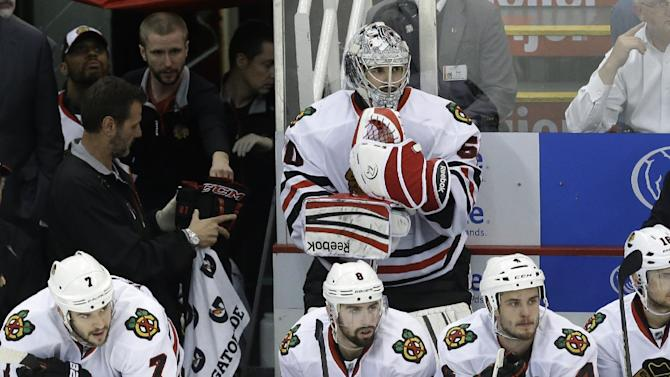 Chicago Blackhawks goalie Corey Crawford (50) watches from the bench after being pulled for another skater during the third period of an NHL hockey Stanley Cup playoffs Western Conference semifinal game against the Detroit Red Wings in Detroit, Monday, May 20, 2013. (AP Photo/Paul Sancya)