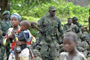 FARDC governmental troops patrol on November 1, 2013 …