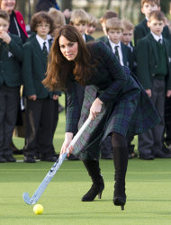 FILE - In this Friday, Nov. 30, 2012 file photo Kate, the Duchess of Cambridge, plays hockey during her visit to St. Andrew&#39;s School, where she attended school from 1986 till 1995, in Pangbourne, England. The Duke and Duchess of Cambridge are very pleased to announce that the Duchess of Cambridge is expecting a baby, St James&#39;s Palace officially announced Monday Dec. 3, 2012. (AP Photo/Arthur Edwards, File)