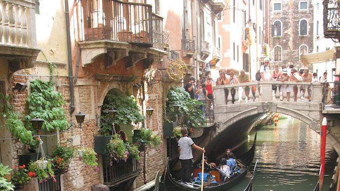 This July 15, 2012 photo shows Gondolas in a traffic jam on the narrow canals of Venice. To travel through northern Italy with a copy of Mark Twain's 1869 ''The Innocents Abroad', his classic 'record of a pleasure trip'. It took him to the great sights of Europe and on to Constantinople and Jerusalem before he sailed home to New York. Such a trip would take far too big a chunk out of my holiday time. But, Milan, Florence and Venice, a mere fragment for Twain, was within my reach for a two-week vacation. (AP Photo/Raf Casert)
