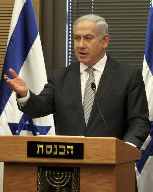 Israeli Prime Minister Benjamin Netanyahu gestures as he speaks during a Likud party meeting at the Knesset, Israel's parliament, in Jerusalem, Tuesday, Sept. 20, 2011. Israeli settlers and Palestinian villagers threw stones at each other Tuesday, a day after Palestinian officials said settlers burned dozens of acres (hectares) of agricultural land and cut down several hundred olive, fig and almond trees. The latest friction came at a sensitive time, with Palestinian President Mahmoud Abbas saying he is determined to seek U.N. recognition this week of a Palestinian state in the West Bank, Gaza and east Jerusalem, areas Israel captured in 1967. Israeli security forces fear the U.N. bid could spark violence in the West Bank. (AP Photo/Tara Todras-Whitehill)