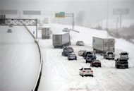 Stalled vehicles are seen during a blizzard as traffic comes to a standstill on the I-635 in Kansas City, Kansas, February 21, 2013. REUTERS/Dave Kaup