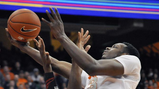 Syracuse's Jerami Grant tries to score the go-ahead basket against Cincinnati's Titus Rubles with seconds to play in an NCAA college basketball game in Syracuse, N.Y., Monday, Jan. 21, 2013. C.J. Fair tipped in the missed effort for what proved to be the game-winner. Syracuse won 57-55. (AP Photo/Kevin Rivoli)
