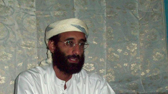 FILE - This Oct. 2008 file photo shows Imam Anwar al-Awlaki in Yemen. Al-Awlaki was born in 1971 in New Mexico where his father was studying agriculture as a Fulbright scholar. The son was educated in the United States but left in 2002, eventually returning to Yemen where he became a key figure in the local al-Qaida branch, which U.S. authorities believed was the most dangerous of the al-Qaida franchises. Al-Awlaki's fluent English and articulate speaking style won him a huge following among disaffected young Muslims in the West. He and another American, Samir Khan, who edited al-Qaida's Internet magazine, were killed in a U.S. drone attack in Yemen on Sept. 30, 2011. (AP Photo/Muhammad ud-Deen, File)