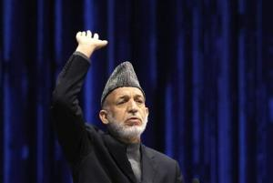 Karzai speaks during the last day of the Loya Jirga, in Kabul