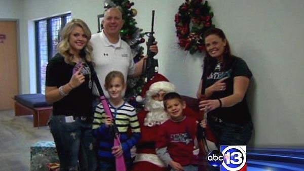 Gun range offers pictures with gun-toting Santa