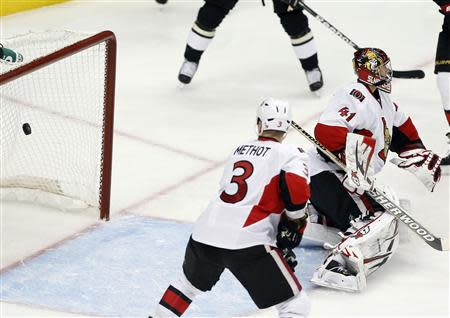 A puck shot by Pittsburgh Penguins James Neal gets past Ottawa Senators goalie Craig Anderson